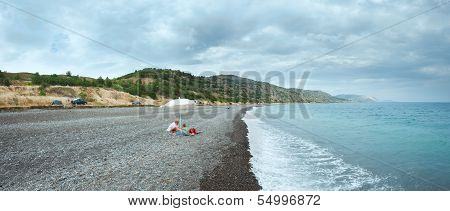 Family On Summer Beach In Crimea, Ukraine.