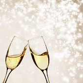 picture of flute  - Glasses with champagne against fireworks and clock close to midnight - JPG