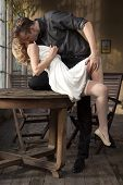 foto of flirt  - Portrait of young adult couple in love posing in classic elegance clothes to date - JPG