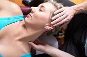 picture of chiropractic  - Female patient on the pin being massaged - JPG