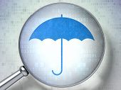 Security concept: Umbrella with optical glass on digital background