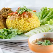 stock photo of gai  - Chicken Rice Curry With Coconut know as Koa Mook Gai in Thailand - JPG