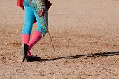 foto of bullfighting  - Bullfighting walking on the sand with his sword - JPG