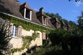 picture of farmhouse  - Old traditional French farmhouse with shabby shutters - JPG