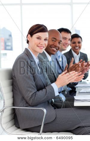 Multi-ethnic Business Applauding A Good Presentation