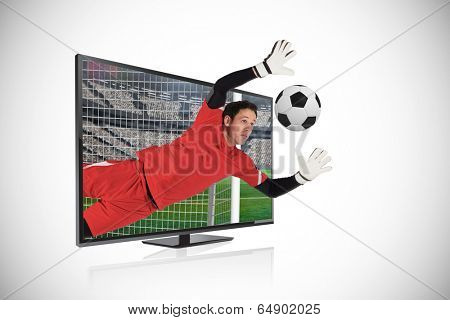 Composite image of fit goal keeper saving goal through tv against white background with vignette