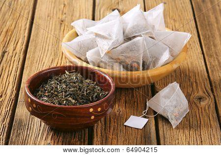 tea bags and bowl with jasmine loose tea