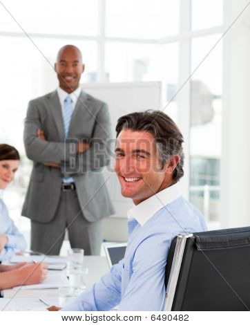 Businessmen In A Meeting With Their Team