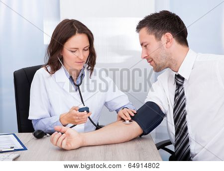 Young Doctor Checking Blood Pressure