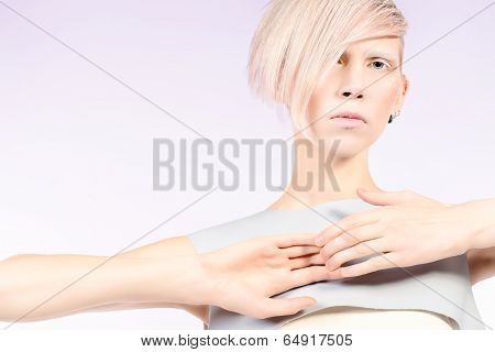 Fashion photo of an extravagant model. Hairstyle, make-up. Isolated over white.
