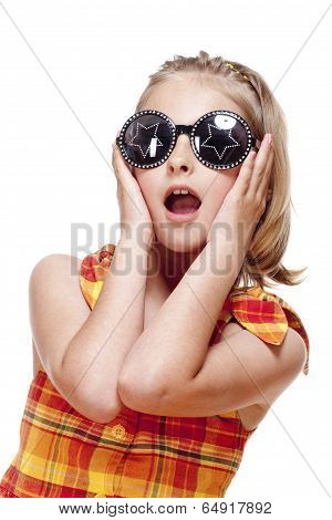 Little Girl With Blond Hair And Funny Glasses