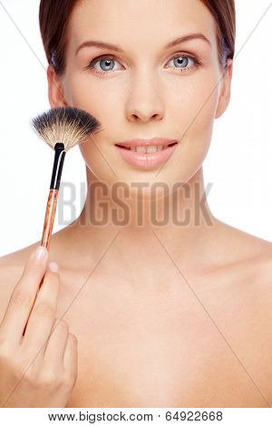 Fresh girl with touch of powder brush over white background