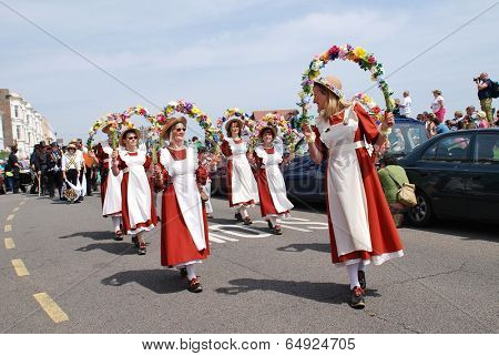HASTINGS, ENGLAND - MAY 5, 2014: Members of the Copperfield Clogs morris dancing team perform during a parade on the West Hill at the annual May Day Jack In The Green festival.