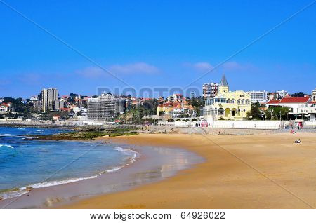ESTORIL, PORTUGAL - MARCH 19: Walkers in the ocean seafront of Praia do Tamariz beach on 19, 2014 in Estoril, Portugal. Estoril is a famous summer vacation location for Portuguese and foreign tourists
