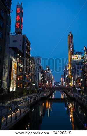 OSAKA, JAPAN - MAY 28, 2008: Artificially dug Dotonbori canal located in the Dotonbori area. This area is very popular among tourists, here are the many restaurants and cafes, shops and nightlife.