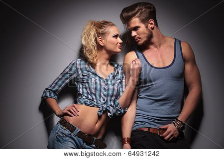 hot young couple looking at each other and smile in studio