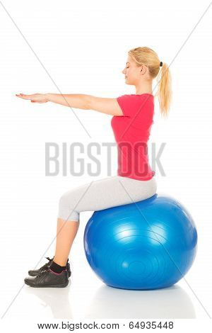 Fitness woman sitting on pilates ball