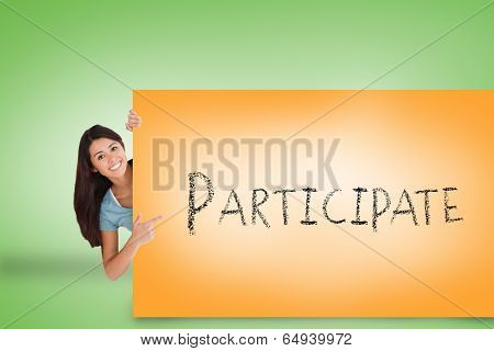 Pretty brunette showing card with participate against green background