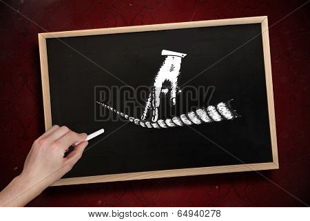 Composite image of hand drawing fingers on tightrope with chalk on chalkboard with wooden frame