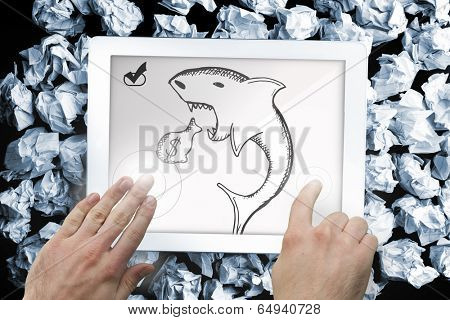 Composite image of hand touching tablet showing loan shark doodle