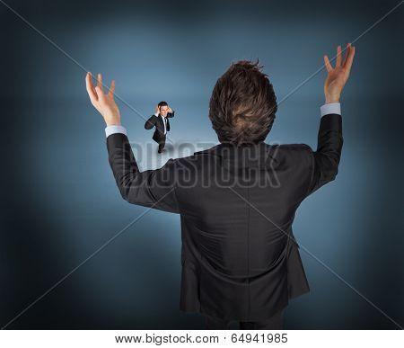 Gesturing businessman with tiny businessman against purple vignette