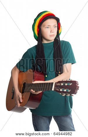 European boy with guitar and hat with artificial dreadlocks.