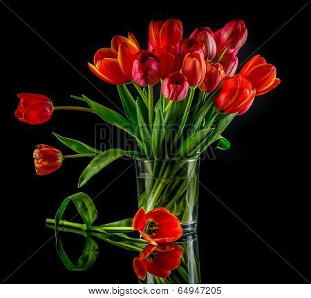 Red tulips on glass vase