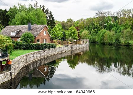 Small Village Lanscape With Calm River