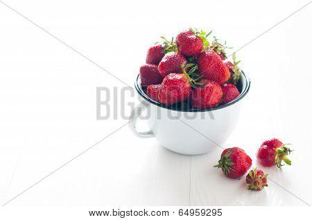 Strawberries In White Enamel Mug