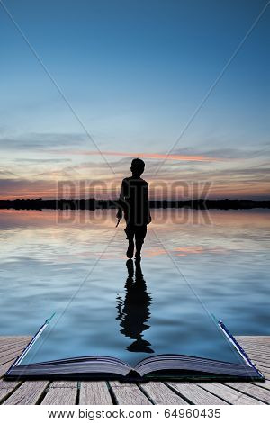 Book Concept Concept Image Of Young Boy Walking On Water In Sunset Landscape