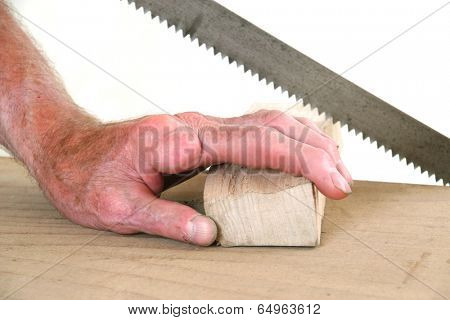 Joiner without one finger sawing a piece of wood