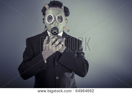 Apocalypse, Business man wearing a gask mask, pollution concept