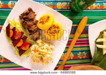 fritada, fried pork, traditional ecuatorian dish.