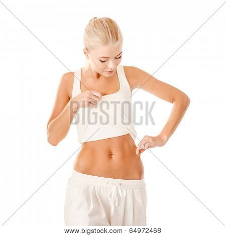 fitness and diet concept - beautiful sporty woman measuring fat level on her waist