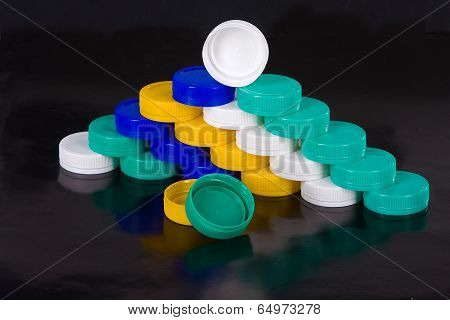 multicolored stoppers for PET bottle