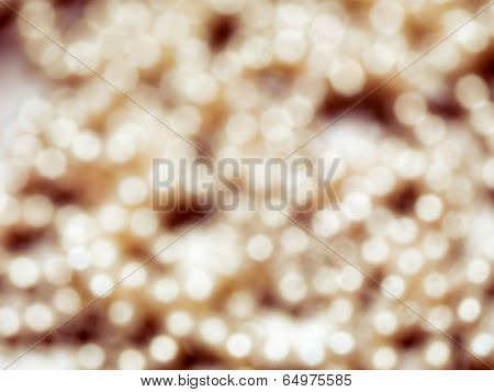 Abstract gold shiny out of focus background texture