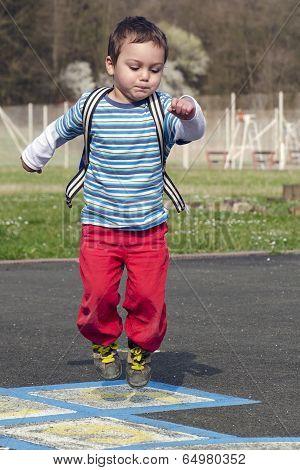 Child Jumping Hopscotch