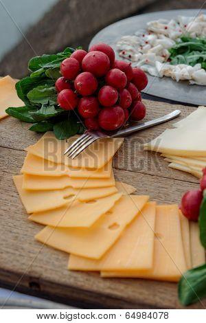 Simple food on table, vineyard scenery in background