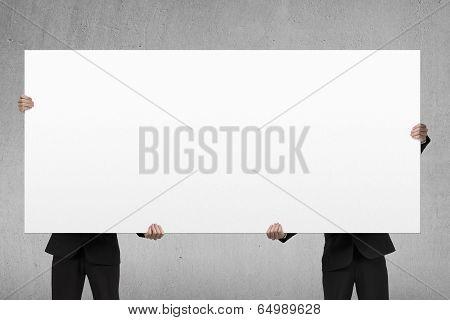 Two Men Lifting Blank Board