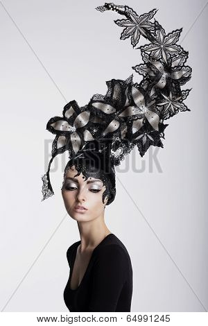 Fantasy. Surrealism. Amazing Woman In Trendy Headwear With Flowers