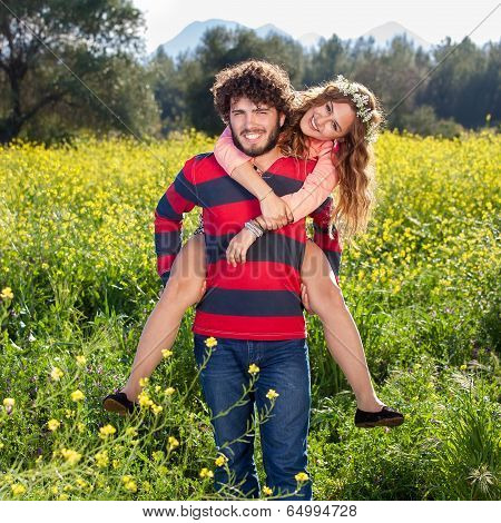 Attractive Happy Carefree Couple In The Country