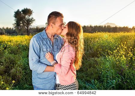 Young Couple Enjoying A Passionate Kiss