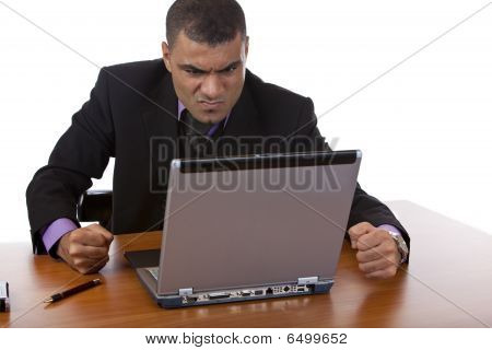 Businessman is stressed in office, because of computer crash