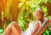 image of sun-tanned  - Cute female on tropical resort - JPG