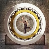 picture of ball bearing  - man run inside of huge ball bearing - JPG