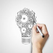 stock photo of electricity  - hand drawing bulb with gears and cogs - JPG