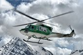 image of rescue helicopter  - Rescue helicopter in the sky above the Alps - JPG