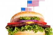 image of hamburger  - A Tasty Hamburger with little American Flags on Top Isolated - JPG