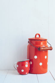 pic of milkman  - Set of vintage utensils milk can and small polka dots milkman home kitchen decor in country style painted white background  - JPG