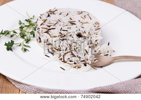 Mixed Cooked Rice With Thyme On White Plate